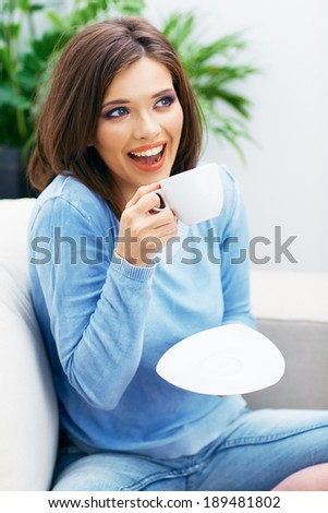 Woman drinking coffee at home. Beautiful girl portrait. - stock photo