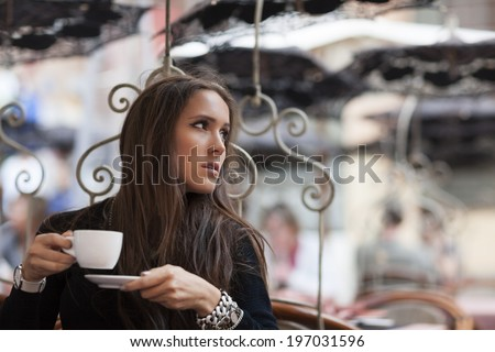 Woman drinking coffee in coffe shop and waiting for her boyfriend