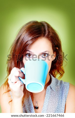 Woman drinking from a cup - stock photo