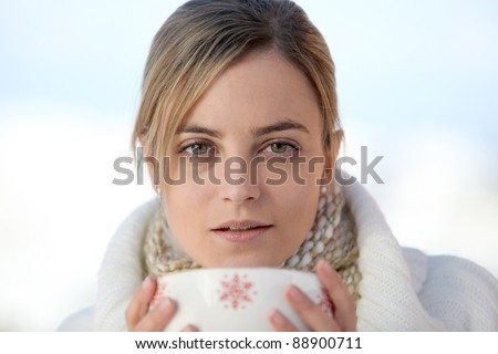 Woman drinking from large mug of coffee - stock photo