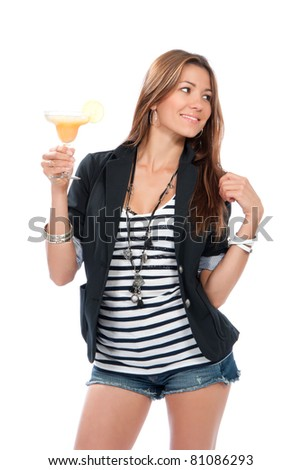 Woman drinking margarita cocktail. Pretty brunette lady holding popular orange margaritas cocktails drink glass with lemon in right hand isolated on a white background