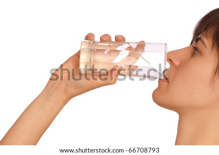 woman drinking mineral water from the glass - stock photo