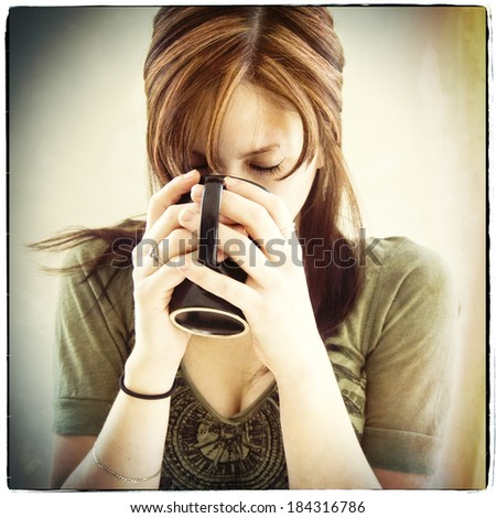 Woman drinking out of a mug, instagram style - stock photo