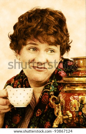 Woman drinking tea in vintage sepia color - stock photo