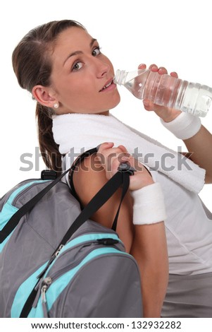 Woman drinking water - stock photo