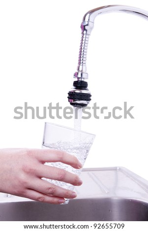 Woman drinking water from the faucet. - stock photo