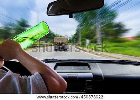 Woman drinking while driving.