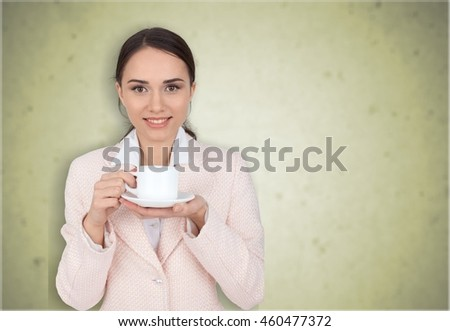 Woman drinks coffee.