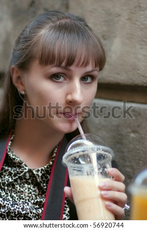 Woman drinks grapefruit juice at Gothic quarter in Barcelona - stock photo