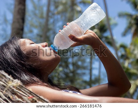 woman drinks water from a bottle - stock photo