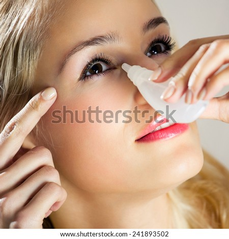 Woman dripping eyes