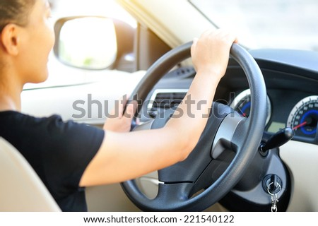 woman driver driving in car  - stock photo