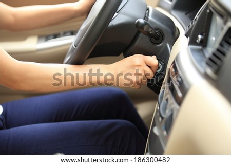 woman driver starting the car  - stock photo