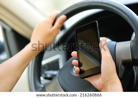 woman driver use her cell phone while driving - stock photo