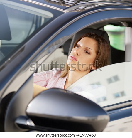 woman driving car in jam. - stock photo