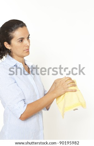 Woman drying hands with a towel