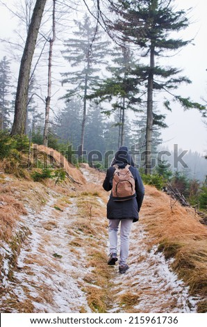 Woman during the hiking in forest - stock photo