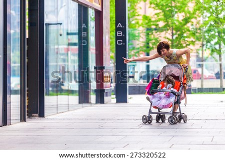 Woman during the shopping with the little girl - stock photo