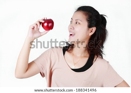 woman eat red apple on white background