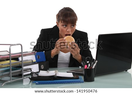 Woman eating a burger - stock photo
