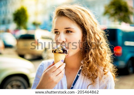 Woman eating a delicious chocolate ice cream - stock photo