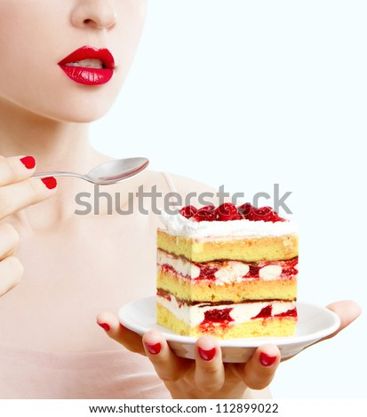woman eating a fruit cake - stock photo