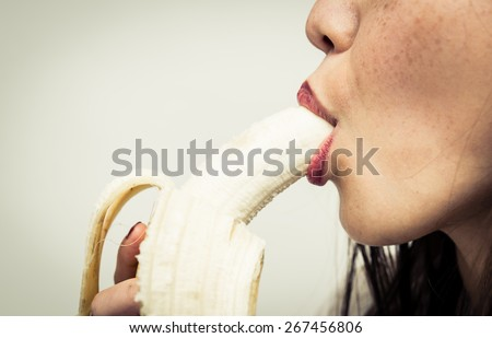 woman eating banana. close up on banana and mouth