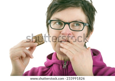 Woman eating biscuit - stock photo
