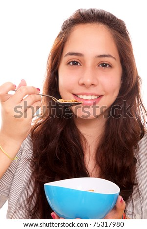 Woman eating cereal in a blue cup as a sign of good nutrition - stock photo