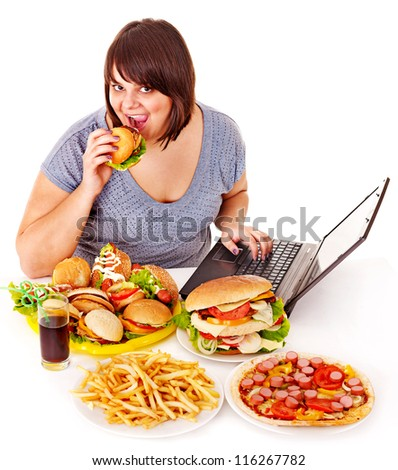 Woman eating fast food at work. Isolated. - stock photo