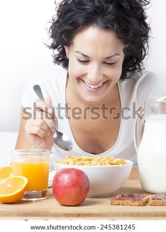 stock-photo-woman-eating-healthy-breakfa