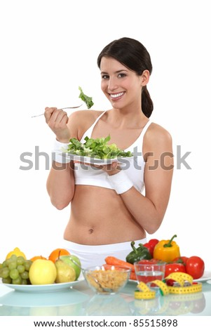 woman eating healthy food - stock photo
