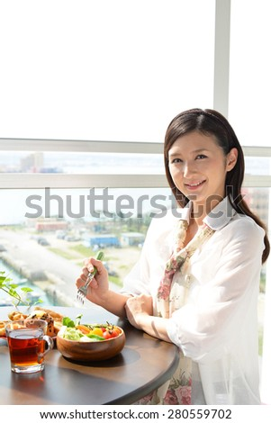 Woman eating meals - stock photo