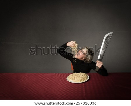 woman eating spaghetti with hands and big fork  - stock photo