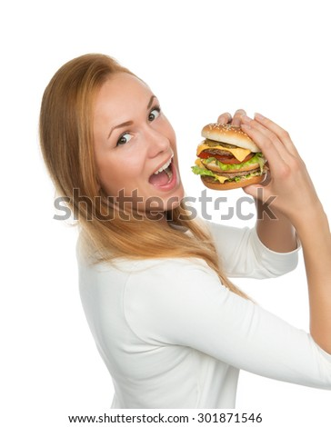 Woman eating tasty unhealthy burger cheeseburger sandwich in hands hungry getting ready to eat isolated on a white background Fast food concept