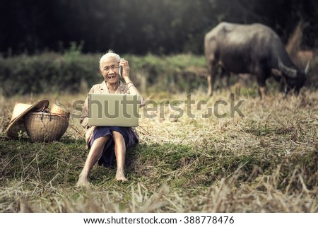 Woman elderly rural residents are using technology - stock photo