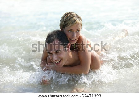 Woman embracing a man in the sea