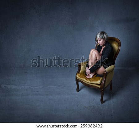 woman embracing legs