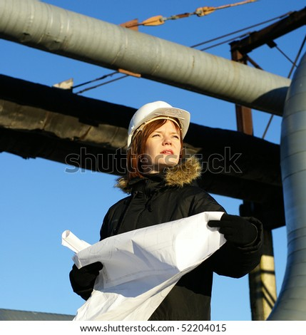 woman engineer against pipelines - stock photo