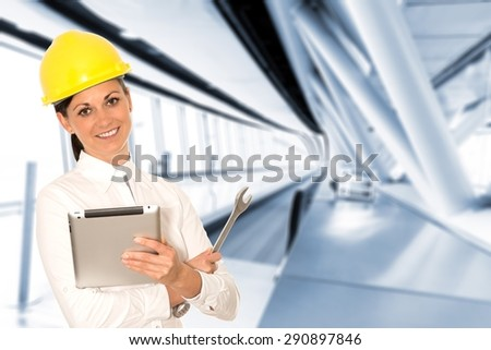 Woman engineer with the tablet and wrench in hands - stock photo