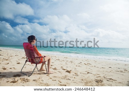 Woman enjoy day at the tropical beach. - stock photo