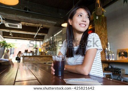 Woman enjoy her coffee at cafe