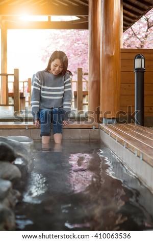 Woman enjoy her foot onsen - stock photo