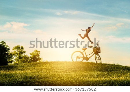 Woman enjoy holiday in the park. She was jumping with happiness - stock photo