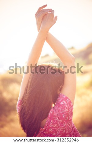 woman enjoy in summer breeze, back shot, outdoor shot on glade - stock photo