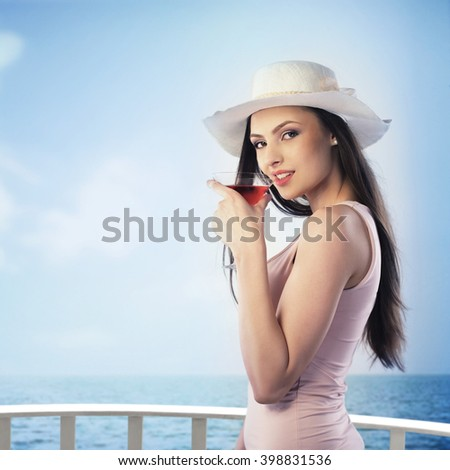 Woman enjoying a drink on a hot summer day
