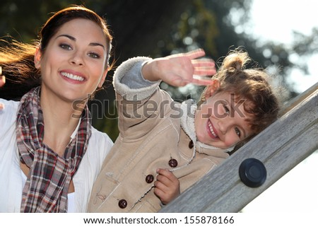 Woman enjoying a lovely day out with her daughter - stock photo