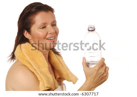 Woman enjoying a refreshing drink after a workout - stock photo