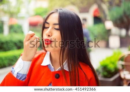 Woman enjoying her desert. Coffee shop restaurant background. - stock photo