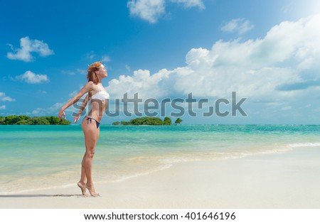 WOman enjoying her vacation on the tropical beach - stock photo